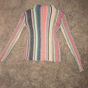 Long sleeve turtleneck sweater.